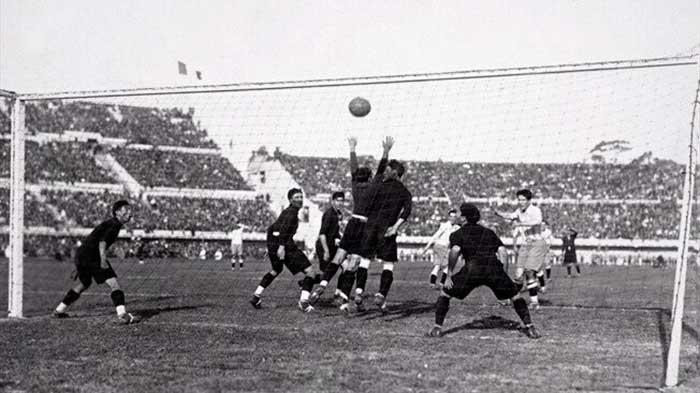 Guillermo Stabile right heads the ball through a crowd of Mexican defenders to score for Argentina