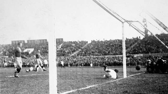 Romanian goalkeeper Ion Lapusneanu is beaten by Uruguays Pablo Dorado for the first goal during the FIFA World Cup match between Uruguay and Romania