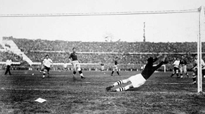 Romanian goalkeeper Ion Lapusneanu dives to make a save during the 1930 FIFA World Cup match between Uruguay and Romania