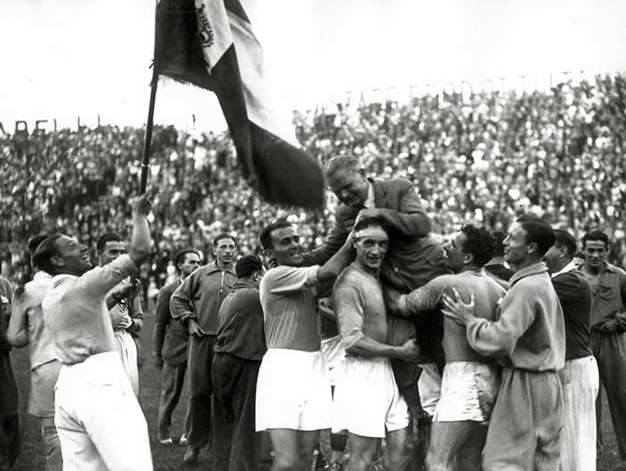 Italy - Czechoslovakia - 2:1. The victorious Italian team carry their coach Vittorio Pozzo as they celebrate an historic victory