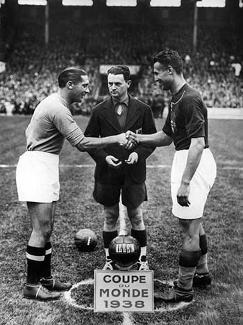 19.06.1938. Italy - Hungary. Giuseppe Meazza (left) shakes hands with Hungarian captain Gyorgy Sarosi. French referee Capdeville