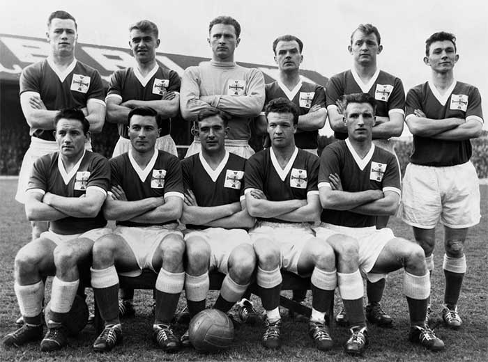 The Northern Ireland football team in 1958: Peter McParland, Billy Bingham, Harry Gregg, William Cunningham, Robert Peacock, Richard Keith, Wilbur Cush, James McIlroy, Danny Blanchflower, Alfred McMichael, William Simpson
