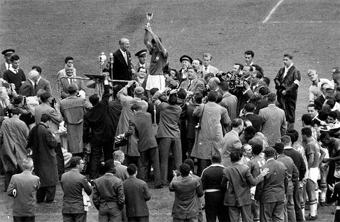 A first World Cup for Brazil eventually arrived at the sixth time of asking in 1958, and heres captain Hilderaldo Luis Bellini holding aloft the Jules Rimet Trophy after Brazils thumping 5:2 victory over hosts Sweden in the final in Stockholm