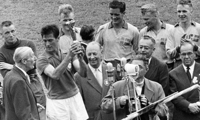 Captain Hilderaldo Luis Bellini holding aloft the Jules Rimet Trophy after Brazils thumping 5:2 victory over hosts Sweden in the final in Stockholm