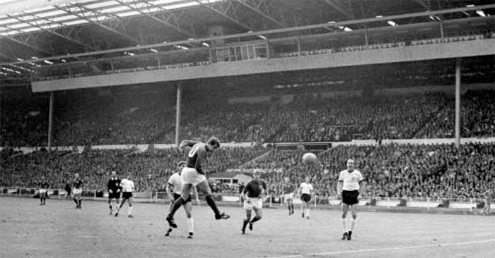 30.07.1966 Англия - ФРГ 4:2. Geoff Hurst brilliantly heads the goal to put England level at 1:1 after West Germanys shock lead in the World Cup Final at Wembley. In the centre is Roger Hunt and on the right Willi Schulz, the German sweeper