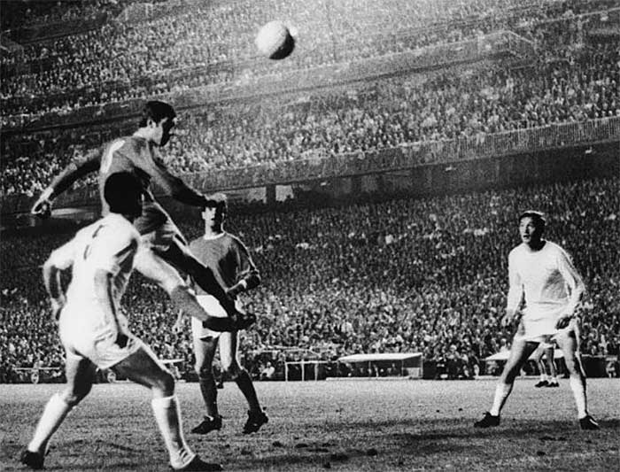 15.05.1968 Brian Kidd of Manchester United gets up to head the ball in the European Cup second leg semi-final against Real Madrid at the Bernabau Stadium in Madrid