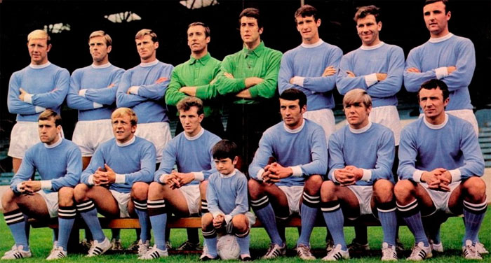 F.C. Manchester City - 1969-1970. Back row: George Heslop, Alan Oakes, Tony Book, Harry Dowd, Ken Mulhearn, Mike Doyle, Bob Kennedy, Glyn Pardoe. Front row: David Connor, Francis Lee, Bobby Owen, Neil Young, Tony Coleman, Mike Summerbee. Sitting: Paul Todd (7 Year Old Mascot).